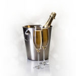 Champagne bottle in bucket with glasses of champagne